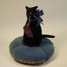 A Black Velvet Cat and a Grey Suede Wee Rat, together are Sittin' on a Blue Velvet Pincushion <3