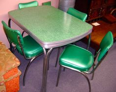 Formica table with tea pot design & pop-up leaf with 3 original Chairs ...