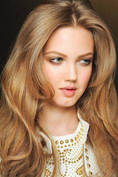 warm, rich, dark blonde hue with wavy hair
