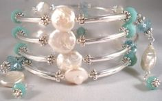 I just can't help it - I love pearls - all kinds of pearls but I especially love freshwater pearls and these coin shaped freshwater pearls are at the top of the list. I love mixing them with crystals and these opaque & translucent turquoise rondelles look amazing!  Add the silver noodles and you have a stunning coil bracelet that is both quick and very easy to create! www.carolynschulz.com