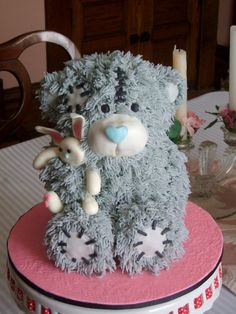 Tatty Teddy Bear Cake - Used a bear pan and then shaped the limbs as if he is holding a bunny toy.