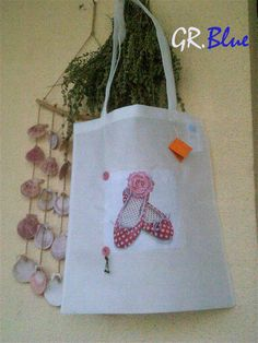 Handmade decorated shopping bag.