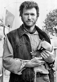 Clint Eastwood holding an armadillo. 1964.