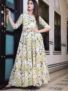 Enchanting cream maslin digital printed gown online available at Inddus.com. Shop this alluring gown for upcoming parties and grand events. Indian Dresses For Girls, Gowns For Girls, Printed Gowns, Suit Fabric, Gowns Online, White Casual, Indian Ethnic Wear, Designer Gowns, Traditional Outfits