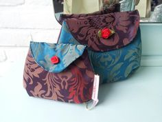 Two matching make-up pouches. They are for sale.