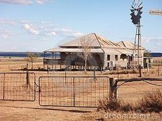 Photo about Photograph of old style Queensland colonial farmhouse on Darling Downs Australia with windmill and driveway in drought conditions. Image of rural, house, queensland - 14333343 Australian Cattle Dog, Australian Farm, Australian Homes, Australian Country Houses, Melbourne, Brisbane, Sydney, Australian Architecture, Colonial Architecture