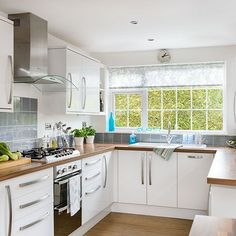Want traditional kitchen decorating ideas? Take a look at this white u-shaped kitchen from Style at Home for inspiration. Find more kitchen decorating and shopping ideas at housetohome.co.uk