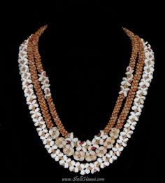 Hawaiian shell jewelry by... Janjira #Puka shell necklace and #Two strand #twisted #Kahelelani shell #leis.