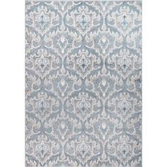 Cambridge Cream/Blue Ornamental Rug (7'10 x 10'2).   $182.99 at Overstock.   There is ivory/beige in the rug - perfect.