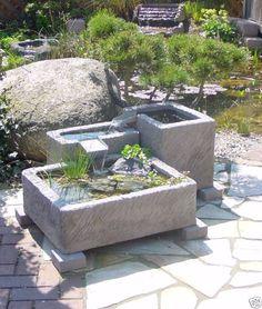 brunnen wasserspiele garten ideen gießkannen steintreppen | garten, Garten und Bauen