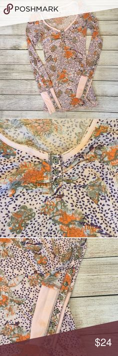 Free People Floral Thermal Unique floral and bird print throughout. Button detailing on sleeves. 50% cotton/50% polyester. Good used condition - there is s small spot on the left sleeve (see last photo).NO TRADES/NO MODELING Free People Tops Tees - Long Sleeve