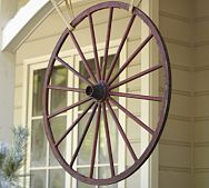 Never thought of hanging my wagon wheel.  Might be interesting.