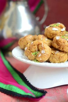 Balushahi is a traditional Indian sweet which is made using all purpose flour, ghee and yogurt. It is crispy from outside and soft and flaky from inside.