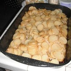 Grilled Garlic Potatoes ~ even though the picture shows in a pan, these are cooked in a foil packet on a campfire or grill.