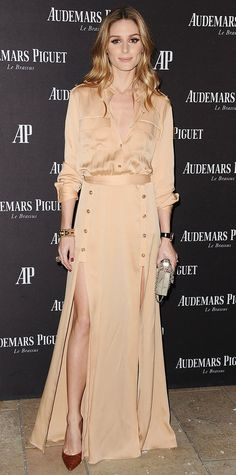 Olivia Palermo celebrated the opening of Audemars Piguet's Rodeo Drive boutique in a pale gold blouse tucked into a color-coordinating double-slit floor-length skirt, styling the monochromatic combo with a gold cuff, an Audemars Piguet timepiece, a box clutch, and brown croc pumps.