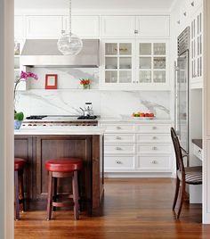 White cabinets, wood island, marble back splash