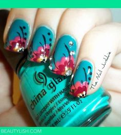 Blue nails with colorful floral design