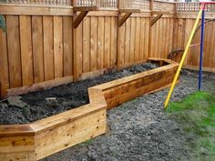 Custom planter boxes by wymanconstruction on Flickr.... Raised planter box along fence that doubles as a bench. Also brackets for hanging plants....