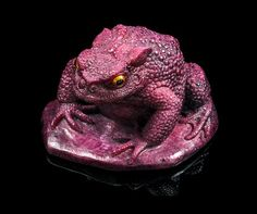 A Carved Ruby Toad, Gerd Dreher,, Idar-Oberstein, Germany,, exquisitely car