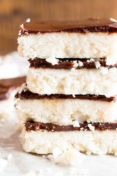 5 Ingredient No Bake Chocolate Coconut Bars (V, GF): A decadent 'n easy dessert recipe for thick, indulgent coconut bars enrobed in a velvety layer of rich chocolate ganache. Healthy Dessert Recipe. #Vegan #GlutenFree #Paleo #Healthy #Desserts #DairyFree | Recipe on BeamingBaker.com