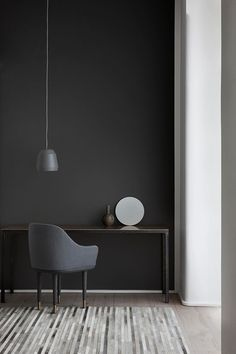 Don't shy away from black paint, after all everything goes with black - we love this feature wall. Inspiration for our Monochrome Twist shoot in the June 16 issue.