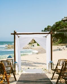 The service took place on the beach, with a view of both surf and sand. With the groom being over a foot taller than the bride, a hardwood aisle was laid so she could don heels without sinking.