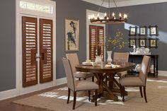Draw attention to beautiful French doors with #WoodShutters featuring a rectangular cutout in Walnut.