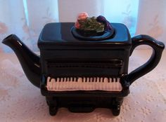I love this piano teapot...found at an estate sale :)