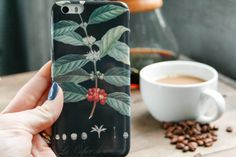 Love coffee? Carry your passion with you all day long. This vintage style botanical illustration of a coffee branch and beans in various stages