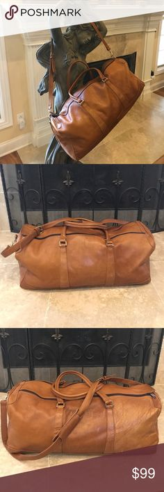 """🎉LARGE LEATHER DUFFLE BAG🎉 LARGE DUFFLE BAG...GENUINE SOFT DARK TAN LEATHER WITH ADJUSTABLE SHOULDER STRAP...   MEASUREMENTS:24""""(L)X9.5""""(H)X10""""(D)  IN GOOD USED CONDITION...CAN BE USED AS A CARRYON WHEN TRAVELING OR AN OVERNIGHT BAG.   FEEL FREE TO ASK ANY QUESTIONS. 💕THANKS FOR VISITING MY CLOSET 💕 Bags Travel Bags"""