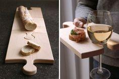 Tablas de madera en forma de pieza de rompecabezas y que se encastran entre sí, ideal para picadas. Foto: Fokal.com