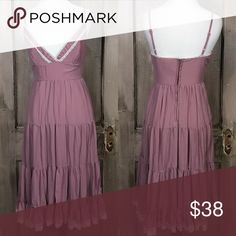 """Bohemian Slip Dress Bohemian flare in mauve with spaghetti straps, gentle crinkle effect, tiered and trimmed in Lace with back zip. Size small Bust 30"""" Waist 25"""" Hip 36"""" Length 41"""" 100% Polyester Hand Wash Line Dry Pristine Condition. Fire Los Angeles Dresses Midi"""