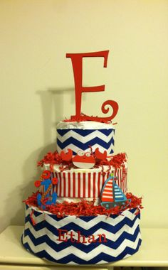 Adorable Nautical themed diaper cake with Letter!  So sweet for a little boy baby shower or gift!