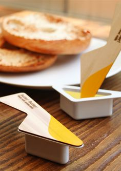 Butter! Better! And in four yummy flavors! The idea here is to package butter in a very convenient single-serve way. Since single serves are usually consumed during travel or picnics, this package includes a wooden spoon lid. The solid spoon is used to spread the butter and does away the need to carry additional cutlery. The idea seems neat and can be extended to yogurts and ice creams too.