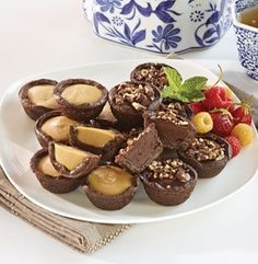 Elegant and fun, bite-sized chocolate cookie mini-cups filled with creamy caramel or chocolate ganache. 16 PIECES - M & M Meat Shops Meat Shop, Chocolate Biscuits, Chocolate Ganache, Bite Size, Luau, Dessert Ideas, Caramel, Frozen, Cookie