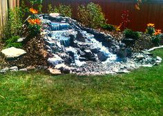 Create Escape Inc. (Calgary) Pond-less waterfall and back yard landscape