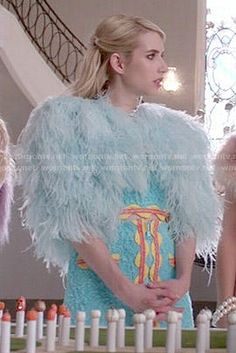 Chanel's turquoise crop top and skirt with orange trim on Scream Queens. Outfit Details: http://wornontv.net/52689/ #ScreamQueens
