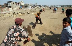 Cricket can offer beautiful imagery even set to the most depressing backdrop. Here kids are playing cricket in the Nehru Nagar slum in Mumbai, enjoying a bash-about to pass the day Urban Intervention, In Mumbai, Slums, Depressing, Kids Playing, Cricket, India, Sports, People