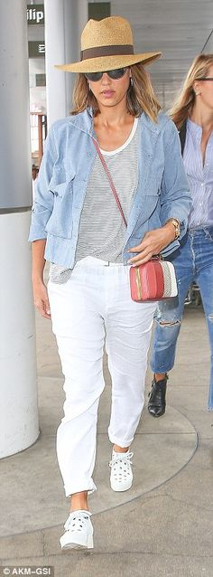 Travel chic: For her flight, the star wore a pair of white cuffed pants with a striped T-s...