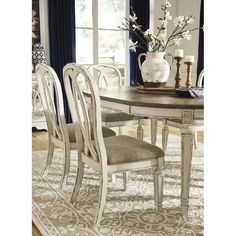 With its stylized ribbon back, chipped white finish and plushly cushioned seat, the Realyn dining room chair has all the right ingredients for a French country-inspired feast for the eyes. White Dining Room Chairs, Dining Room Walls, Dining Room Design, Dining Tables, Living Room, Round Dining, French Dining Chairs, Dining Decor, Small Dining