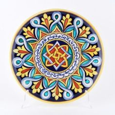 Francesca Niccacci's geometric designs are a unique blend of intricate patterns and richly shaded colors.Entirely handmade and hand painted, Niccacci's geometric serving bowls and platters are artful interpreters of the Italian ceramic heritage at its best.