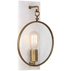 Make a statement with this sophisticated wall sconce featuring aged bronze finish accents and alabaster stone.