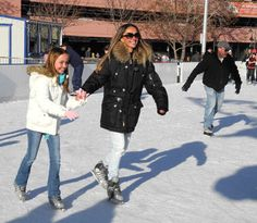 Ice skaters enjoy a sunny winter day at Rink on the River in Reno, Nevada, NV