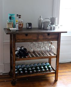 This Ikea Hack transformed an Ikea kitchen cart and glass rack into an elegant bar cart. Bar Carts are beautiful but can be extremely expensive and often do not have built in storage for wine glasses. Ikea Kitchen Cart, Ikea Bar Cart, Diy Bar Cart, Bar Cart Decor, Bar Carts, Bar Trolley, Diy Kitchen, Bar Cart Wood, Ikea Trolley