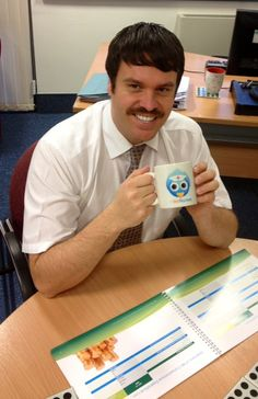 """Craig Harris, Exec Lead Nurse for Manchester Clinical Commissioning Groups showing off his """"movember"""" tash and the #twug"""