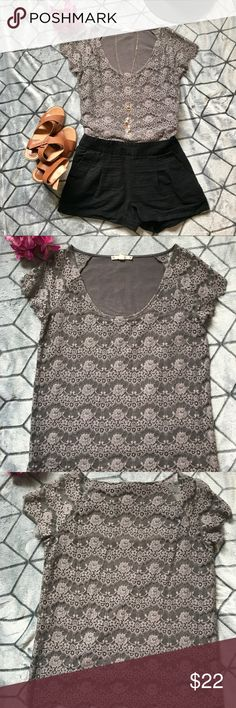 Pretty Lace Top Pretty gray lace short sleeve top, lined, lace hems, feminine scoop neck. The lace is so pretty and will dress up any casual outfit any time of year. So cute with jeans and boots, high waisted shorts, maxi skirts, you name it! Worn a few times, I have got so many compliments in this top, in great condition. Anthropologie Tops