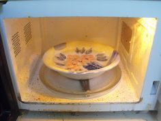 Heat a bowl of water and vinegar for 5 minutes in the microwave, the steam will dissolve stuck on stains.