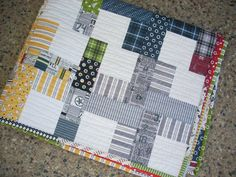 Varsity by Sweetwater fabric! love the sports theme of this line! I designed this quilt for a blog tour with Fat Quarter Shop using a Jolly Bar of Varsity this piece would make a great man-quilt or even a wonderful little boy quilt for the sports lover guy! the quilt measures about 33.5 x 40.5  message me with any questions thanks for taking a look