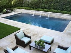 Photo slideshow of Artistic Gardens' design projects: seating area on flagstone terrace surrounding swimming pool with fountain spouts Backyard Pool Landscaping, Backyard Pool Designs, Small Backyard Landscaping, Swimming Pools Backyard, Backyard Retreat, Swimming Pool Designs, Modern Backyard Design, Garden Design, Lap Pools