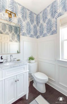 Powder Room Design Ideas in this Makeover Reveal, featuring picture frame moulding and blue palm wallpaper. Gorgeous bright & airy powder bathroom reveal makeover with blue & white palm frond wallpaper, silver faucet, golden mirror. Coastal Powder Room, Powder Room Decor, Powder Room Design, Powder Room Lighting, Palm Wallpaper, Powder Room Wallpaper, Coastal Wallpaper, Wallpaper Ideas, Bad Inspiration